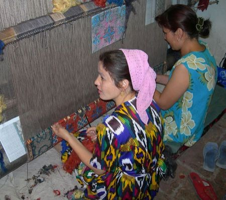 ...and perhaps  local woman weaving one of the famous silk and wool Bukharan rugs.