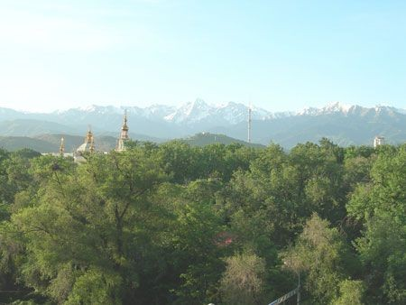 Back in Almaty, the view from the hotel window reveals our final destination – the Tien Shan Mountains...