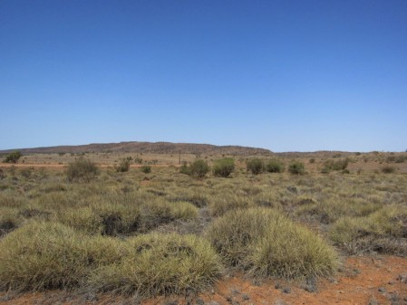 Seemingly barren fields of Spinifex and the rocky lower slopes of the mountains support